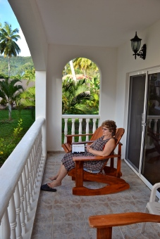 Kaye's favorite reading spot in the DR was either the veranda or the poolside.