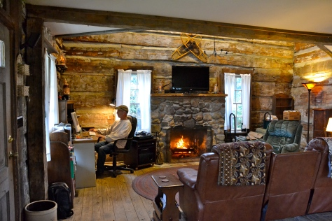 Here I am feeling at home in my office in a corner of the historical log cabin.
