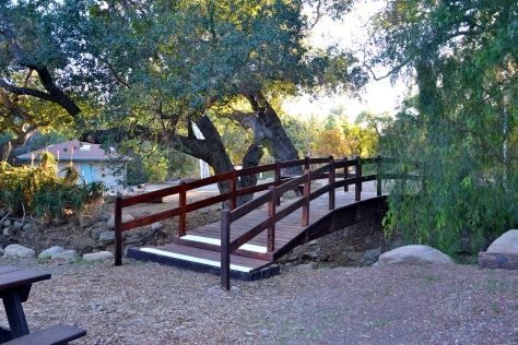 There are three beautiful foot bridges spanning a dry creek bed in the park.