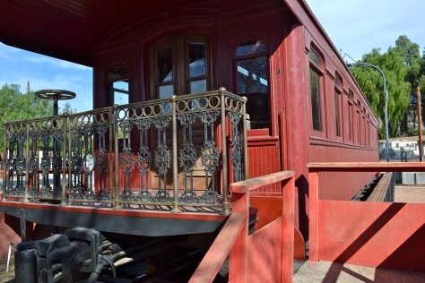 This caboose is one of a score of railroad cars and engines at the Fillmore railroad museum.