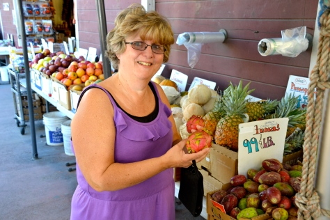 Kaye checks out the dragon fruit at a local open-air farm market.  Hard to find that one in Michigan.