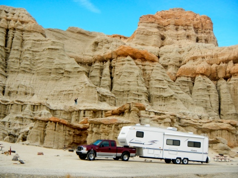 The rig is dwarfed by the cliffs at Red Rocks Canyon.