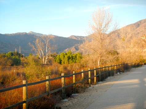 The bike trail along the dry Sespe Creek bed reveals the mountains behind the camp.