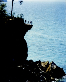 Hikers at the Pictured Rocks, Michigan.