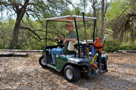 Golf carts shuttle tools and workers to and from the various work sites.