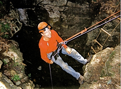 Here I'm rappelling into the 30-foot pit entrance of Coon's Cave.