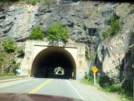 One tunnel leads to another on the road through the mountains.