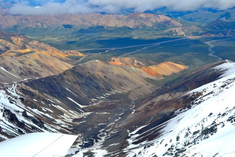 An aerial view of the Polychrome Mountains also reveals a distance glimpse of the Parks Highway on the other side of the valley.