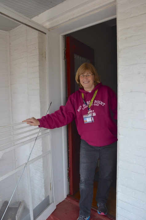 Nancy welcomes new workers to the front door of the old keepers house.
