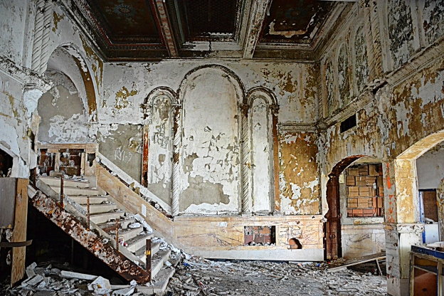 The inner lobby and stairway entertain ghosts of the past.