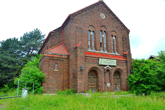 The splendor of the past is still visible on the brick facade of the St. Margaret Mary Catholic Church.