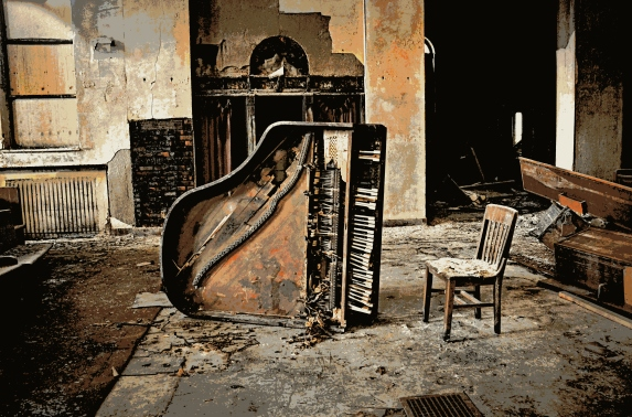 The metal strings are missing from the not-so-grand piano, having been salvaged by scrappers.