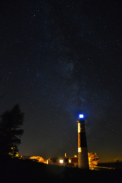 The Milky Way hangs above the 112-foot lighthouse at Big Sable Point. Ludington, Michigan.