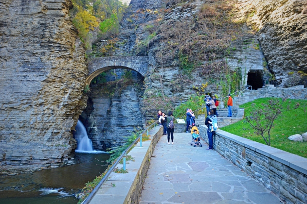 Visitors enter Watkins Glen through a tunnel (right) and stairways onto the first of several stone bridges.