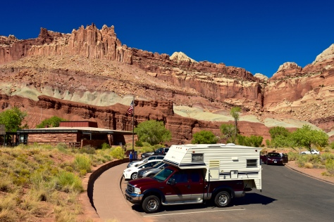 Great red cliffs loom above the park visitor center - and my truck.