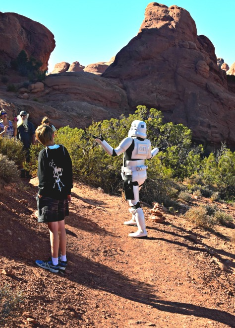 Young Liam steps to the side while tourists snap photos of his dad, Brack Lee, as the stormtrooper.