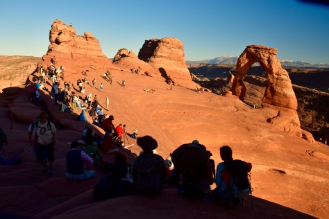 Fans of Delicat Arch hike uphill for a mile-and-a-half to gaze at the rock until sunset.