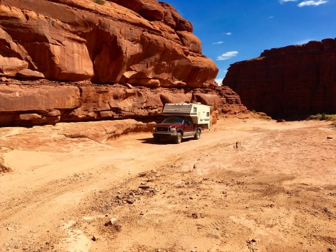 I drove up a dry wash for a while, between cliffs of red rock.
