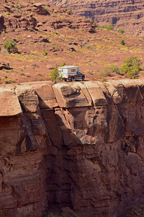 The road follows the edge of the White Rim which is 1000 feet above the Colorado River. The drop-offs are impressive.